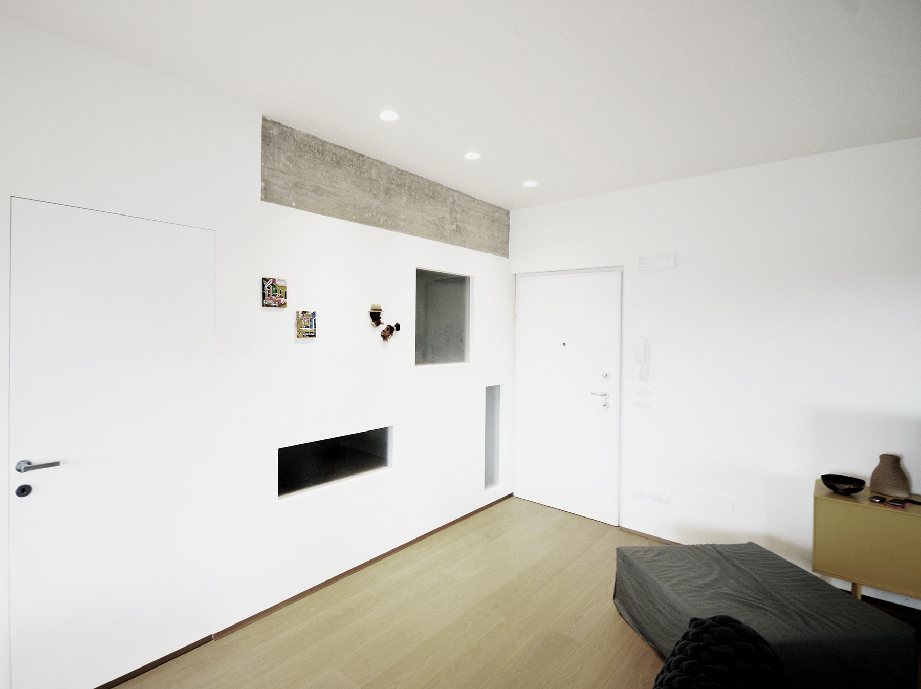 casa SP. ingresso e zona divani TV