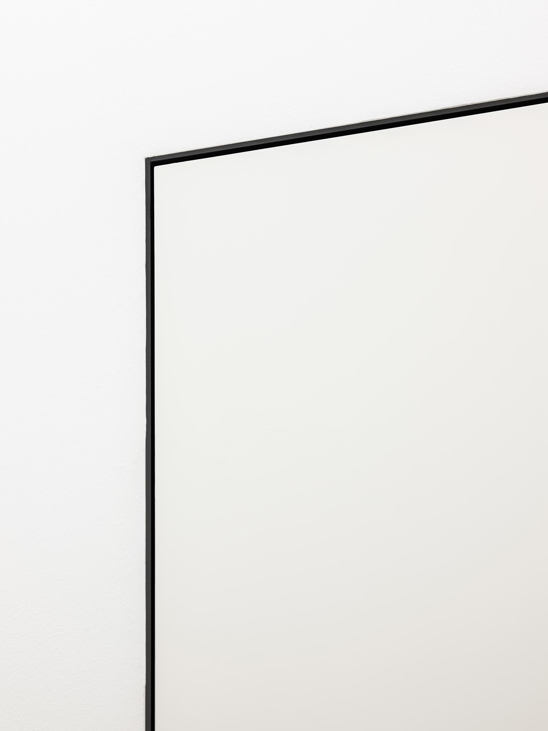 eclisse40 Collection - vista dello showroom di Milano in via delle Armi 2 - particolare in alto lato filo muro